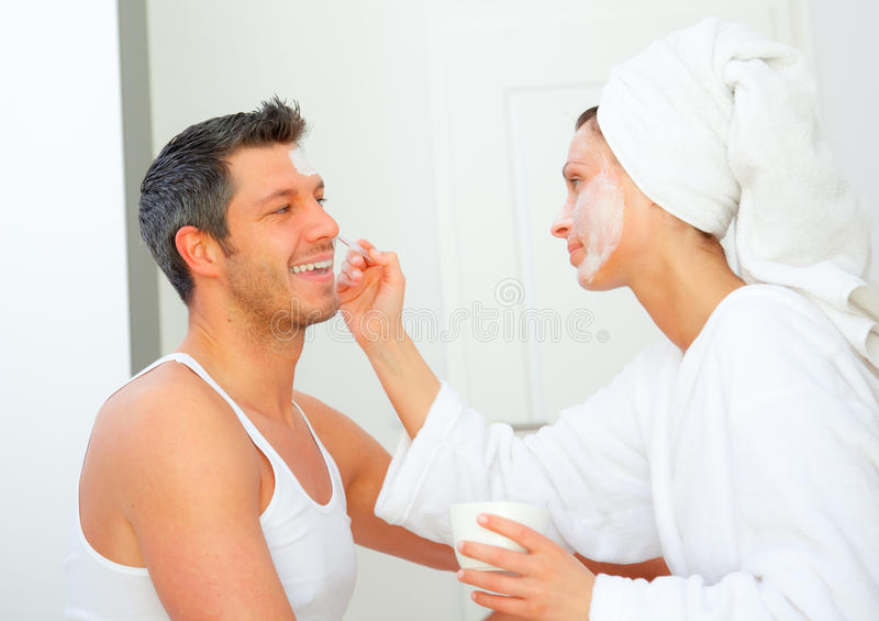 Dayspa wellness couple. Dayspa couple applying cosmetic products eachother stock photos