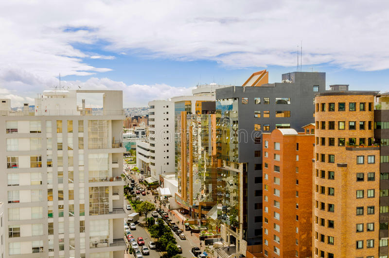 Daytime city street with tall buildings stock photography