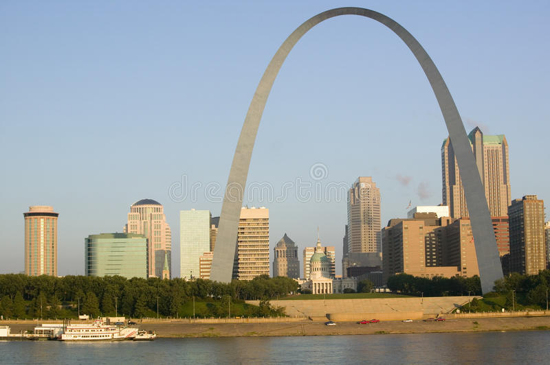 Daytime view of Gateway Arch (Gateway to the West) and skyline of St. Louis, Missouri at sunrise from East St. Louis, Illinois on royalty free stock images