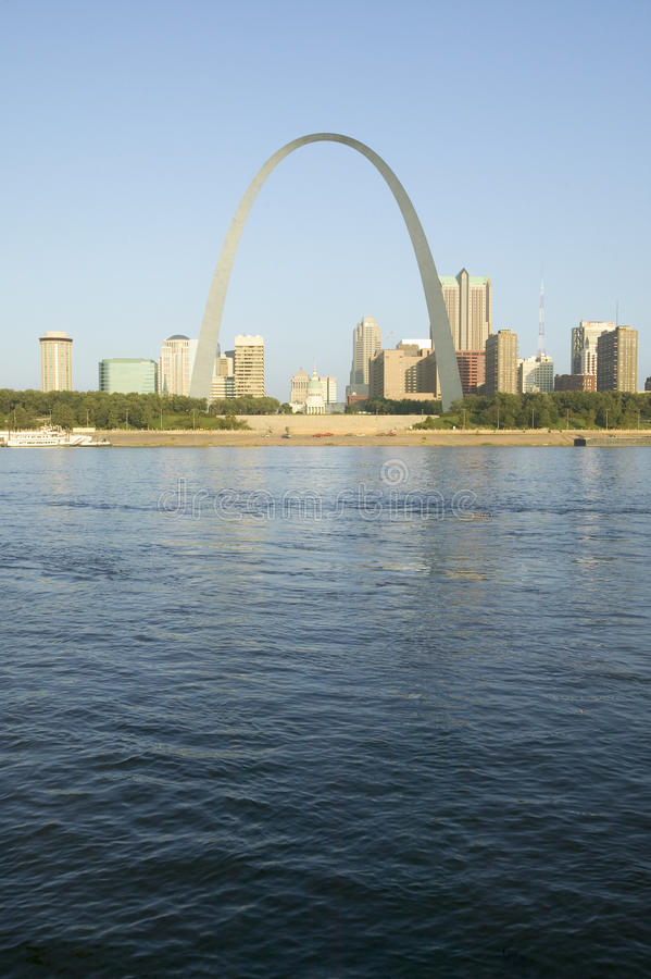 Daytime view of Gateway Arch (Gateway to the West) and skyline of St. Louis, Missouri at sunrise from East St. Louis, Illinois on stock images