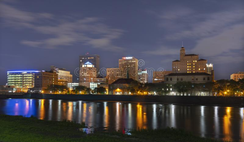 Dayton, Ohio at Night. The Downtown Area of Dayton Ohio as seen from the bike trails along the Great Miami River stock photo