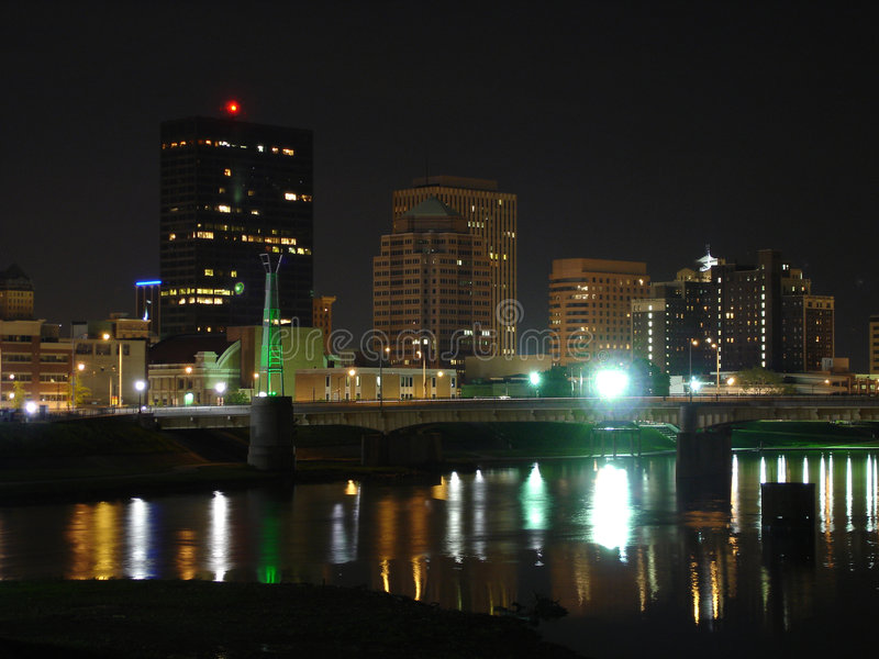 Dayton, Ohio Skyline at Night with River. Skyline of Dayton, Ohio at night with river and bridge stock photo