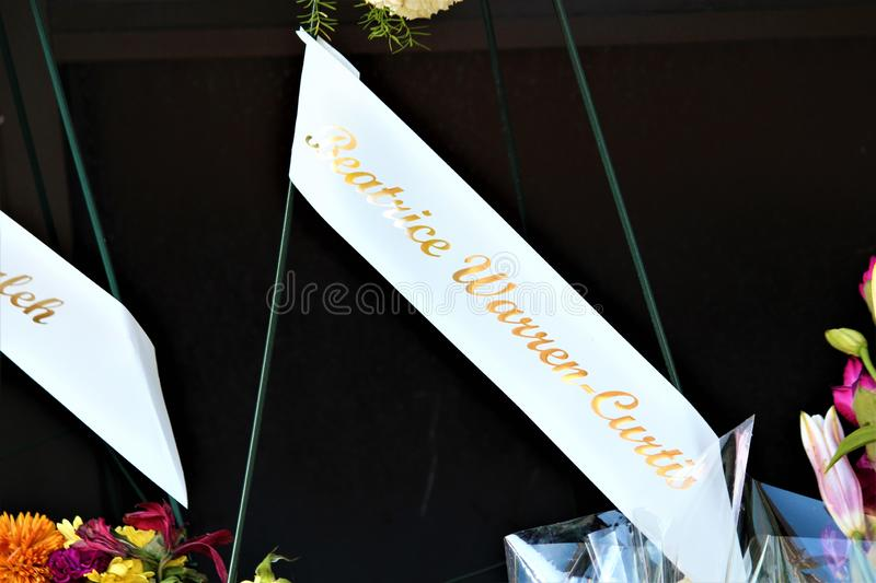 Dayton, Ohio / United States - August 7 2019: A memorial for the Oregon District victims. Dayton, Ohio / United States - August 7 2019: Bouquets line the street royalty free stock image