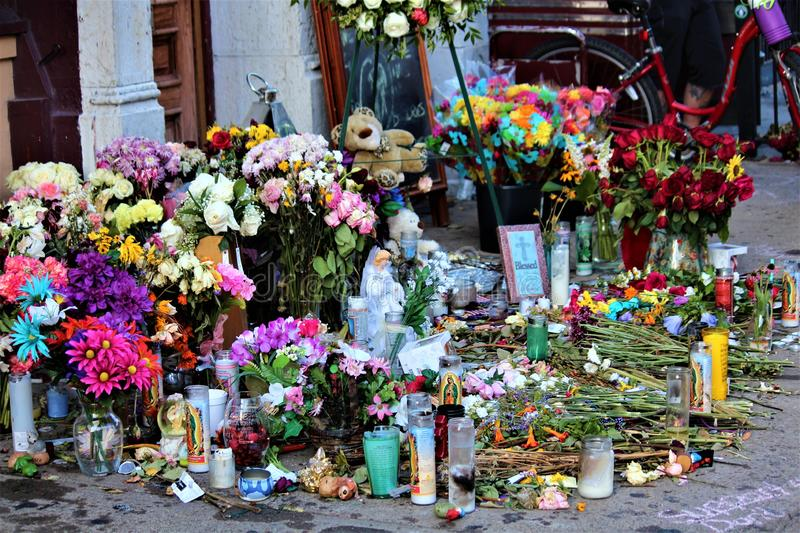 Dayton, Ohio / United States - August 7 2019: A memorial for the Oregon District victims. Dayton, Ohio / United States - August 7 2019: Bouquets line the street royalty free stock images