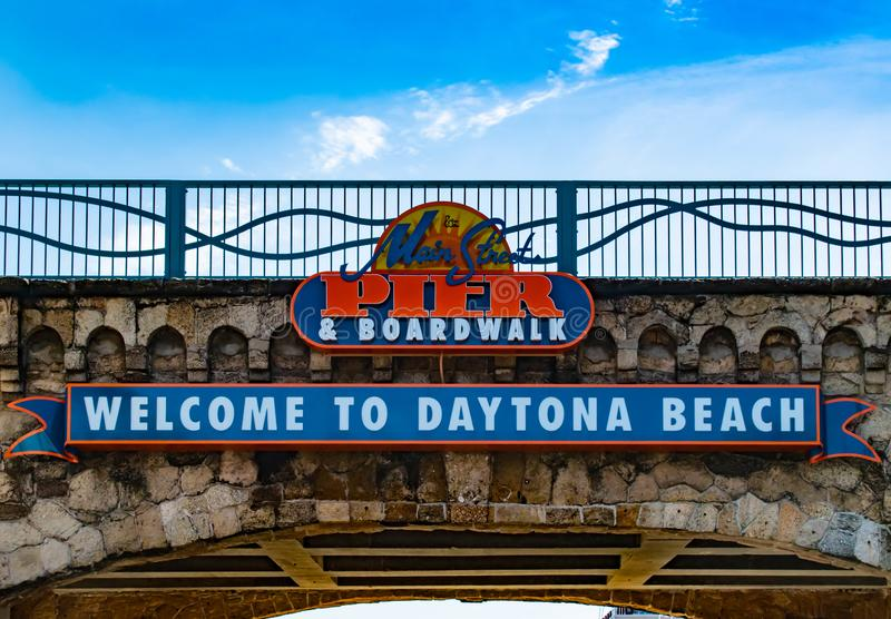 Top view of Welcome to Daytona Beach and Pier AND Boardwalk sign. royalty free stock image
