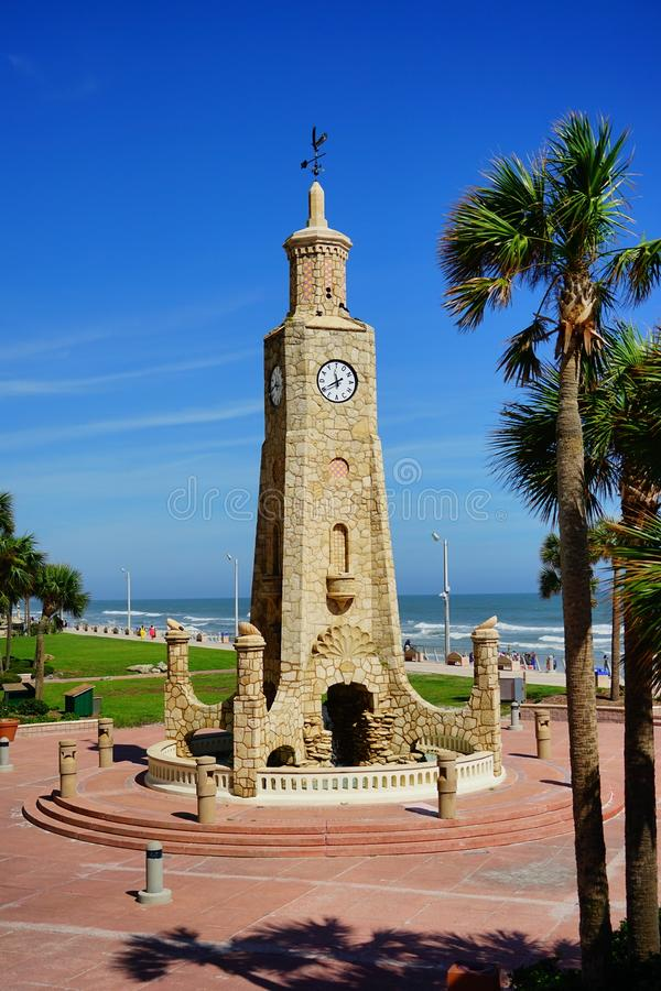 Daytona Beach tower in Florida. Daytona Beach landscape: tower clock and palm tree, Florida, USA stock photography