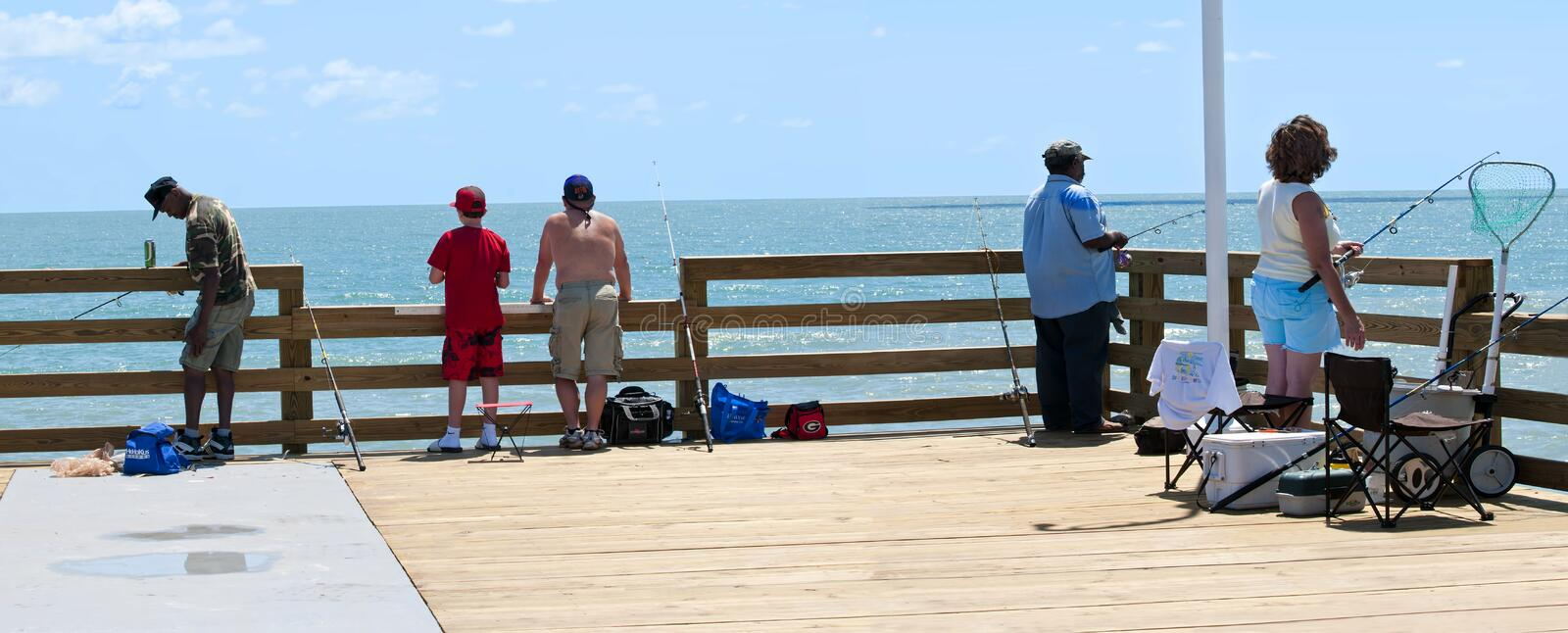 Daytona Beach Pier. DAYTONA BEACH, FLORIDA, UNITED STATES - JUNE 18, 2012: FISHING PIER. Fishermen enjoying the renovated fishing pier at Daytona Beach, Florida stock images