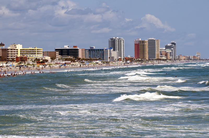 Daytona Beach Skyline. DAYTONA BEACH, FLORIDA, UNITED STATES - JUNE 18, 2012. BEACH ACTIVITY People enjoying the beach and ocean with hotels and condominiums in stock photography