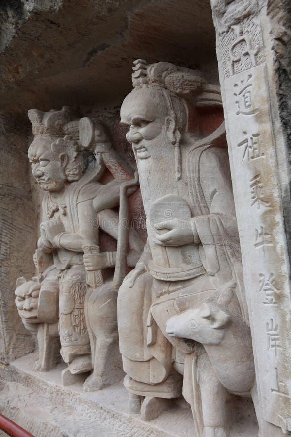Dazu carvings. Ancient dazu carvings,near Chongqing , China. Original carvings date back to 892 AD stock image