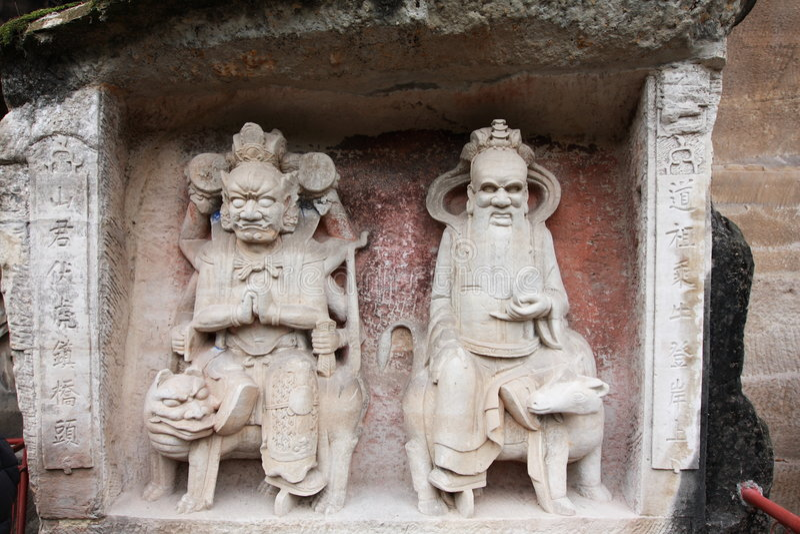 Dazu carvings. Ancient dazu carvings,near Chongqing , China. Original carvings date back to 892 AD royalty free stock image