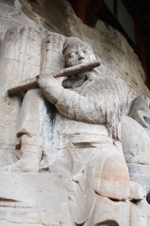Dazu carvings. Ancient dazu carvings, near Chongqing , China. Original carvings date back to 892 AD stock photo