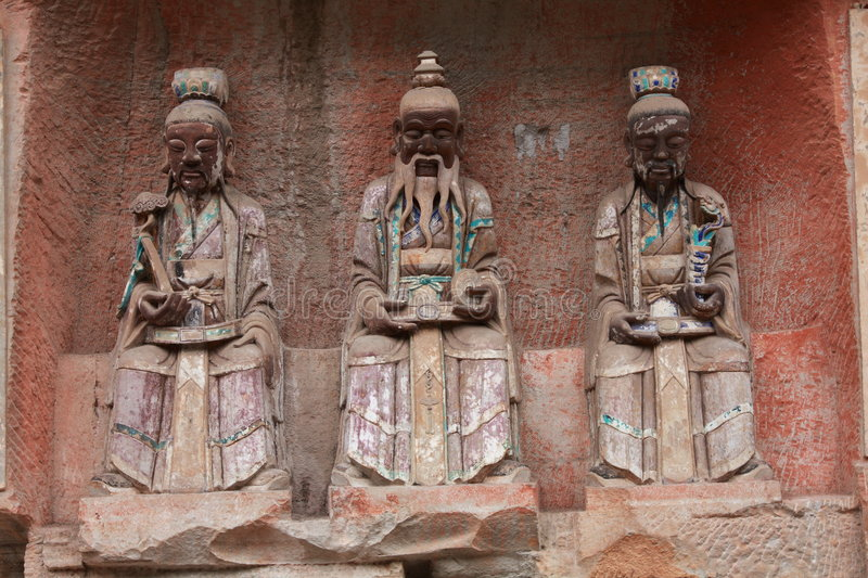 Dazu Rock Carvings. The Dazu Rock Carvings (Chinese: 大足石刻; pinyin: Dàzú Shíkè) are a series of Chinese religious sculptures and stock photo