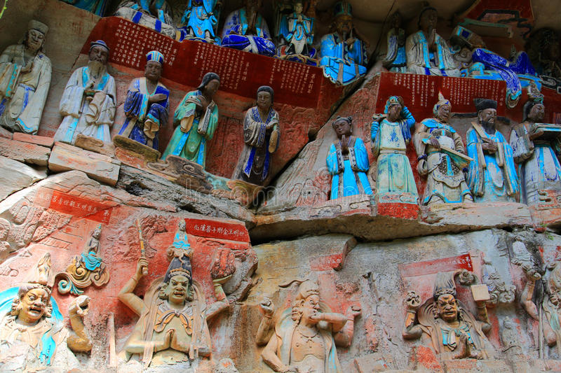 Dazu rock carvings,chongqing,china. The Dazu Rock Carvings are a series of Chinese religious sculptures and carvings, dating back as far as the 7th century A.D royalty free stock images