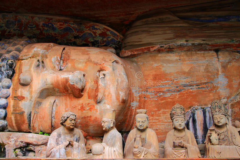 Dazu rock carvings,chongqing,china. The Dazu Rock Carvings are a series of Chinese religious sculptures and carvings, dating back as far as the 7th century A.D royalty free stock photography