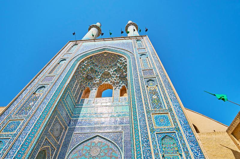 Main portal of great Friday Mosque, Yazd, Iran. The dazzling tilework of the main portal iwan of medieval Friday Jameh Mosque, blue gamma tile pieces connected stock images