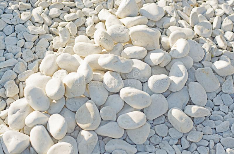 Dazzling white stones of different sizes, illuminated by the sun. Large and small., mountains, beach. Autumn royalty free stock photos