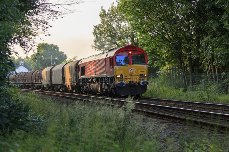DB Schenker liveried Class 66 No 66001. Passes Weston Rhyn level crossing heading towards Shrewsbury. United Kingdom royalty free stock photography