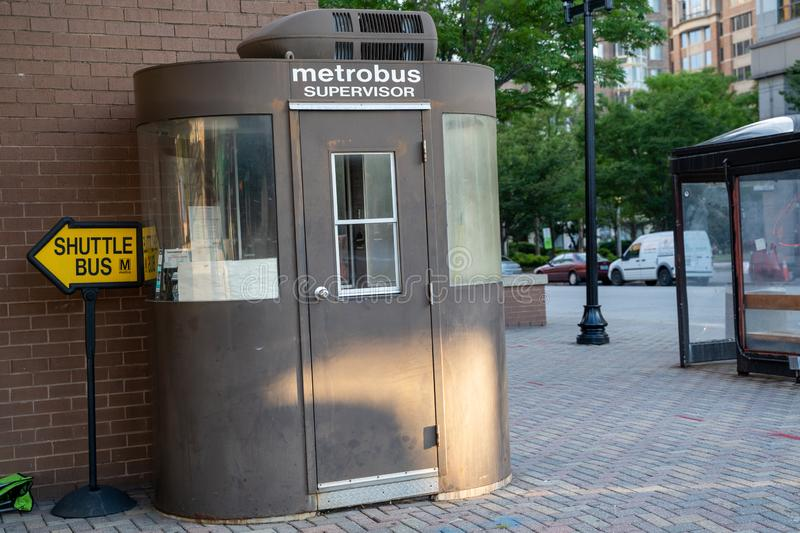 A DC Metrobus Supervisor station booth, located outside of the Ballston metro station. Arlington, Virginia - August 7, 2019: A DC Metrobus Supervisor station stock images