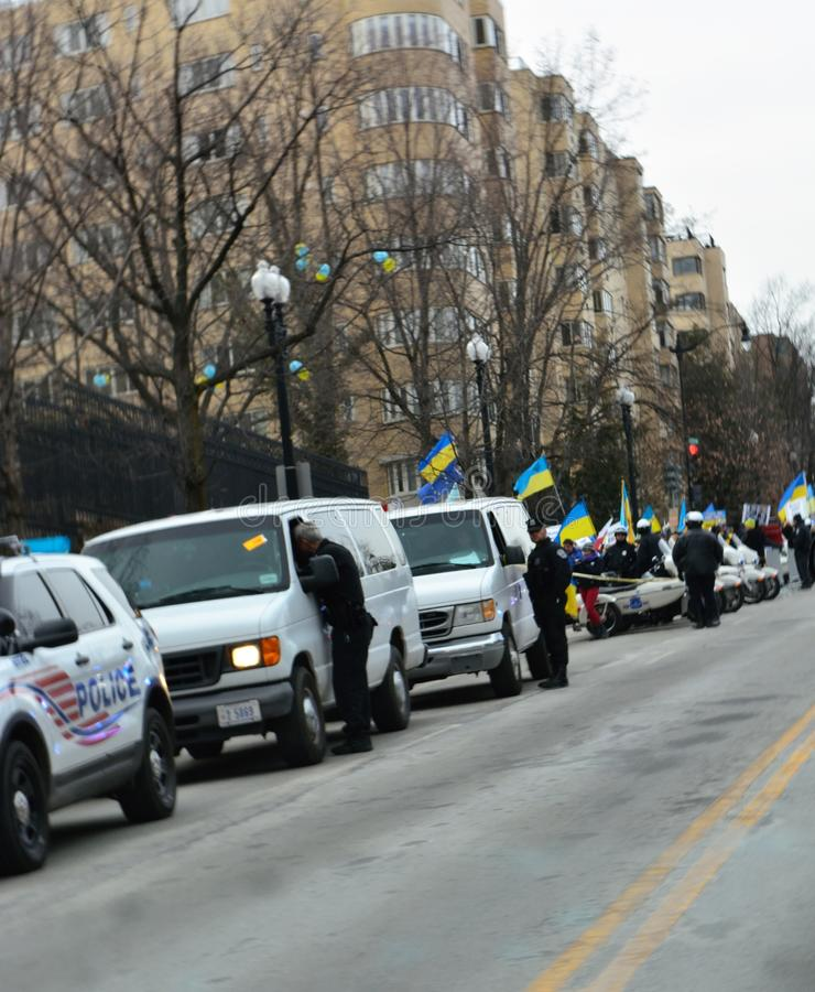 DC Police at Ukraine Protest. DC Metro police monitoring Ukraine protest outside Russian Embassy royalty free stock photography