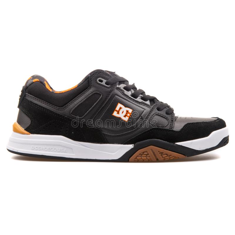 DC Stag 2 JH black and orange sneaker. VIENNA, AUSTRIA - AUGUST 25, 2017: DC Stag 2 JH black and orange sneaker on white background royalty free stock photos