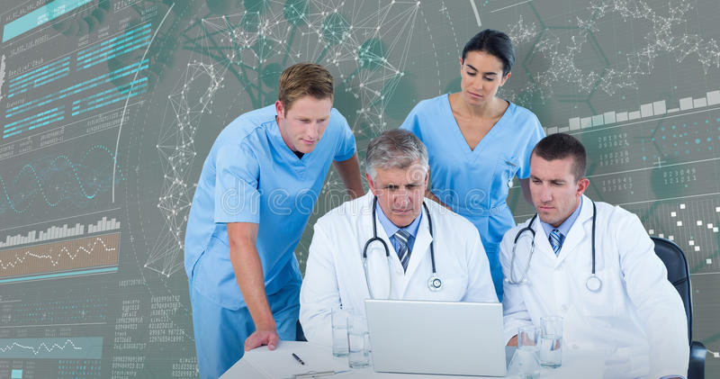 3DComposite image of team of doctors using laptop at desk royalty free stock photo