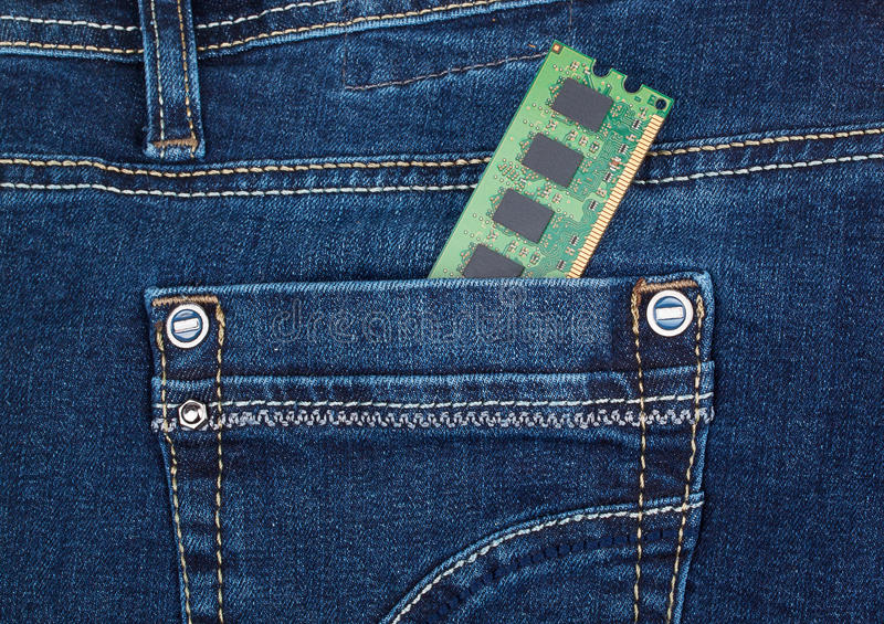 DDR2 memory module in pocket of blue jeans stock photo