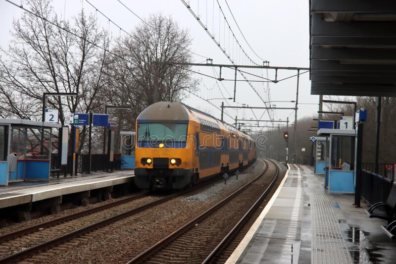 DDZ intercity train heading to Rotterdam along platform of Nieuwerkerk aan den IJssel in the Netherlands stock photo