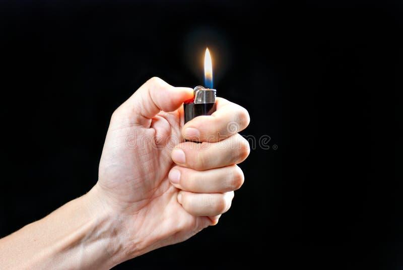 De Aansteker van Lit van de Holding van de hand stock fotografie