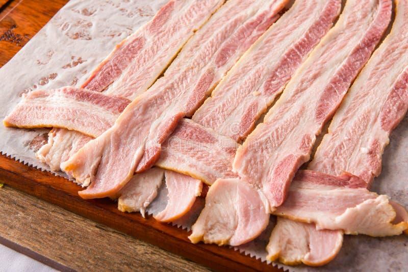 De aanvang van een baconweefsel royalty-vrije stock afbeeldingen