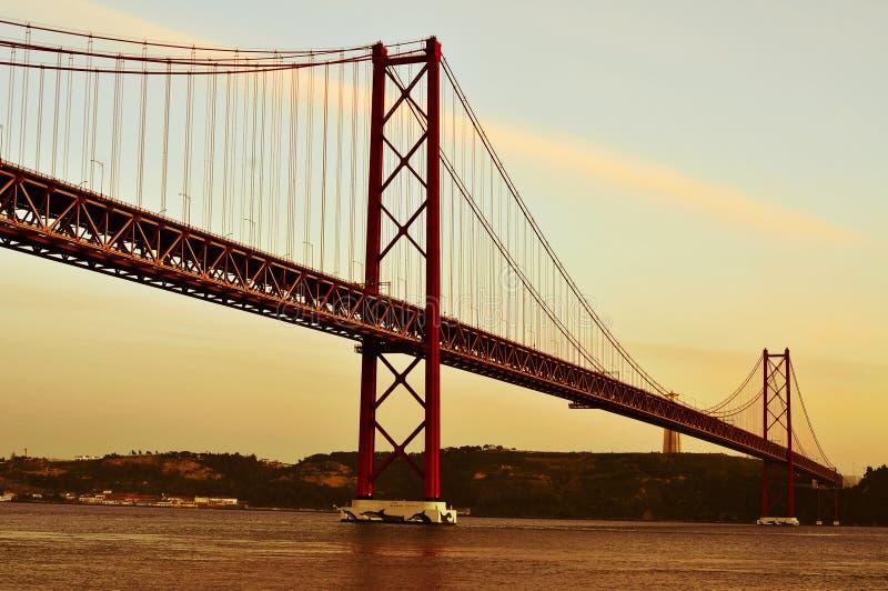 25 de Abril Bridge in Lisbon, Portugal, with a filter effect. View of the 25 de Abril Bridge and the Cristo Rei in Lisbon, Portugal, with a filter effect stock photos