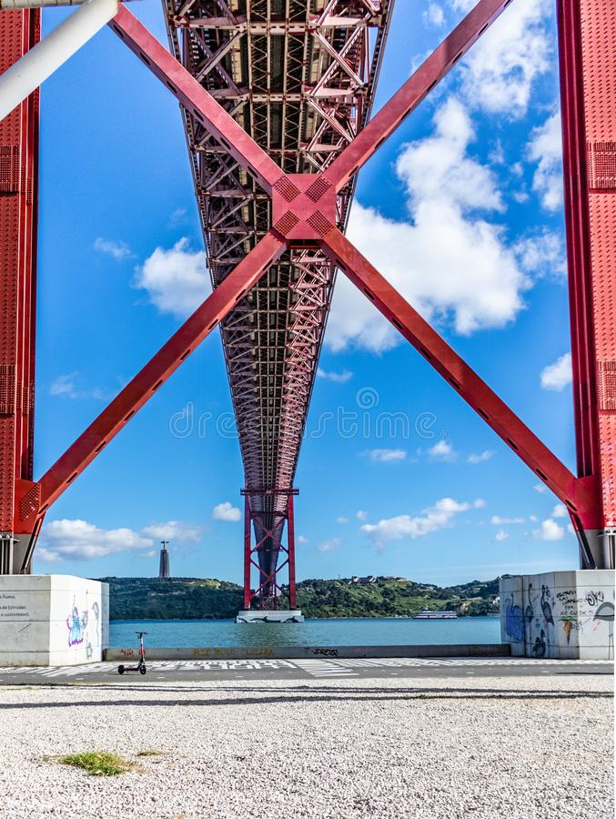 25 de abril bridge from lower angle with its two 1st pillars. In the bank of tejo river. Date 20 may 2019 royalty free stock images