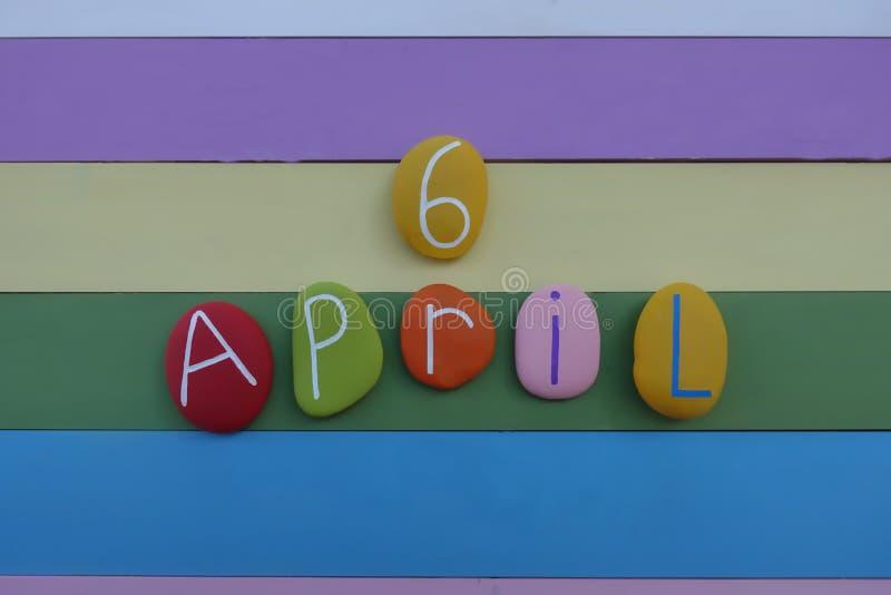 6 de abril, compuesto con las piedras coloreadas sobre un tablero de madera coloreado multi ilustración del vector