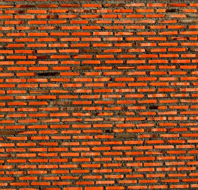 De abstracte achtergrond van de close-up rode bakstenen muur royalty-vrije stock afbeeldingen