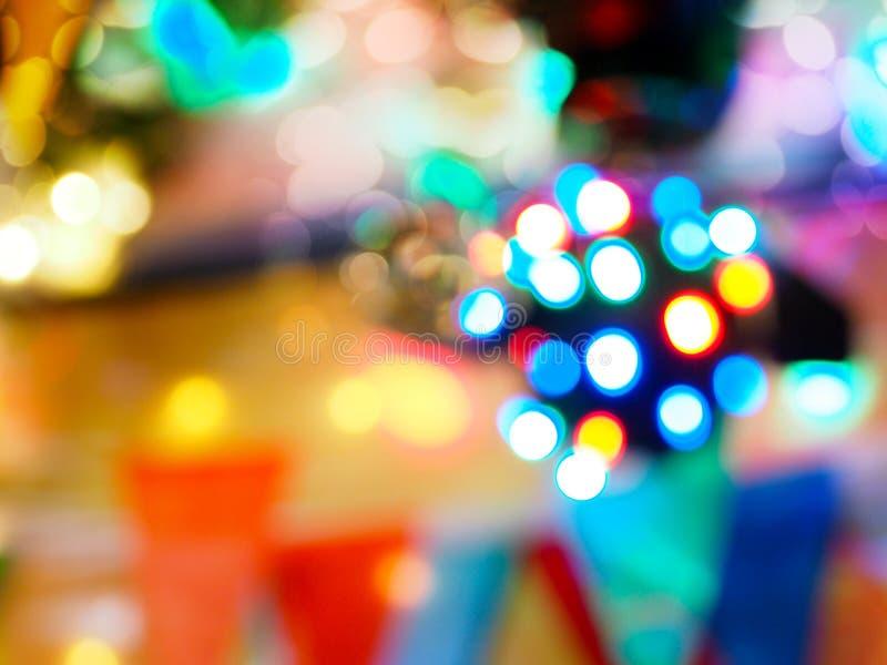 De abstracte onduidelijk beeldachtergrond van het licht van de discobal voor partij onderhoudt royalty-vrije stock foto's