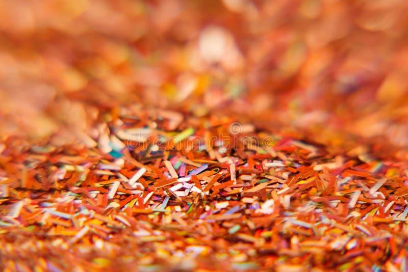 De abstracte rode achtergrond met multicolored schittert Patroon Achtergrond stock fotografie