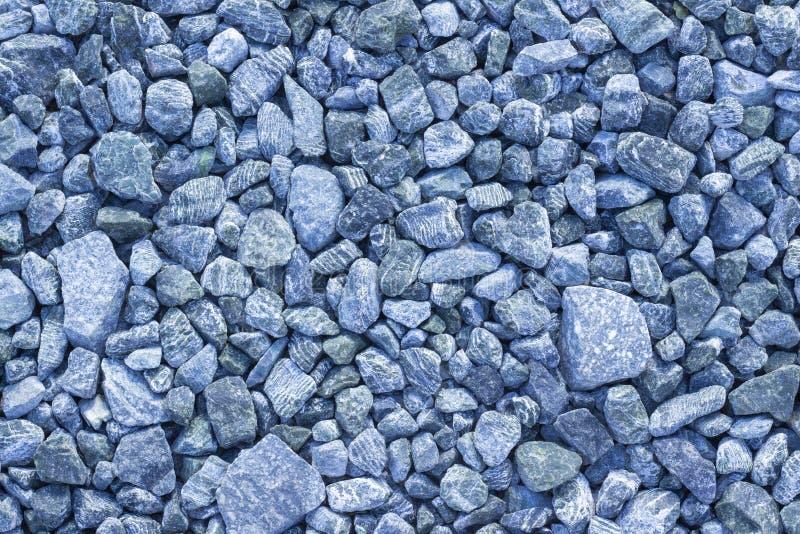 De abstracte textuur achtergrondexemplaarruimte verpletterde vers blauwe verpletterde steen stock afbeelding