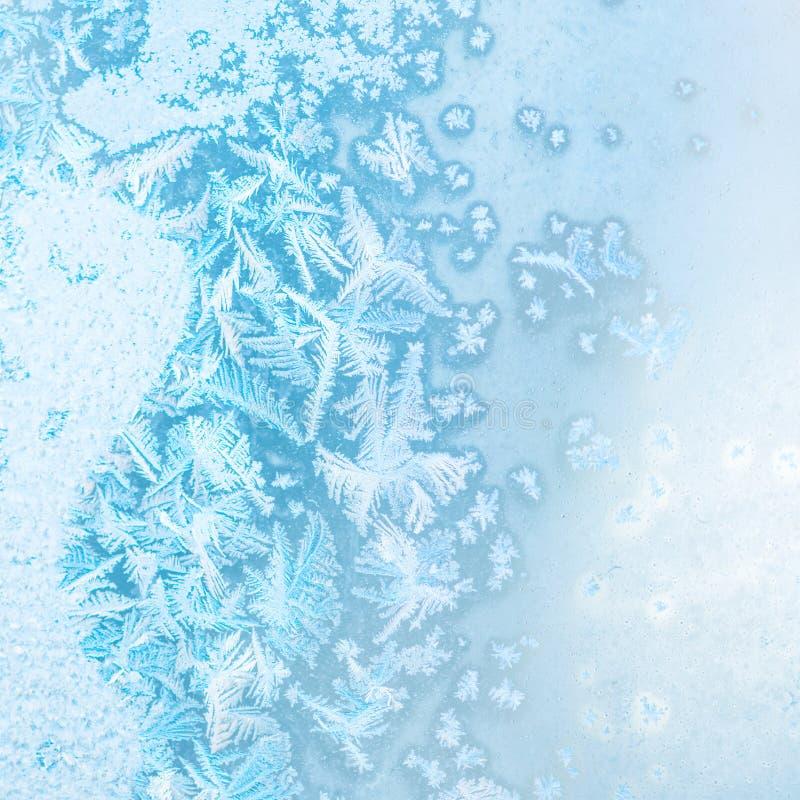 De abstracte textuur van het de winterijs op venster, feestelijke achtergrond, sluit royalty-vrije stock foto