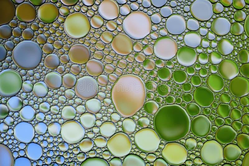 De abstracte veelkleurige waterolie borrelt textuur Kleurrijke achtergrond stock foto's