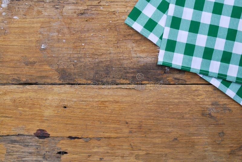 De achtergrond maakte van tafelkleed op oude lijst stock afbeeldingen