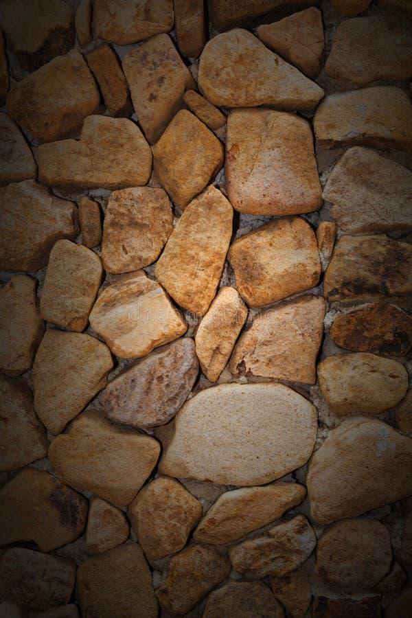 De Achtergrond van de close-uptextuur van Natuurlijke rots of Steen arrang royalty-vrije stock afbeelding