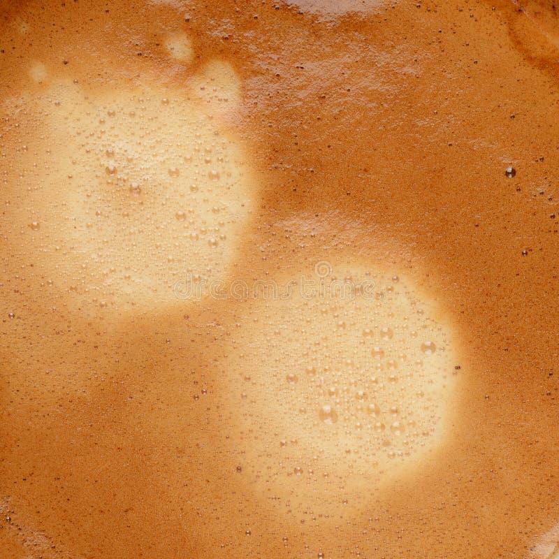 De achtergrond van de crematextuur van de koffieespresso stock afbeelding