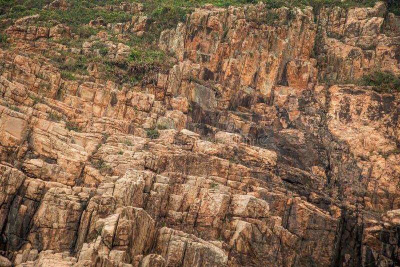 De achtergrond van de de klippentextuur van de steenberg stock afbeelding