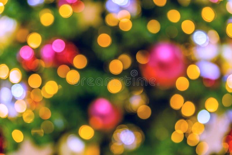 De Achtergrond van de kerstboom Bokeh defocused lichten stock afbeeldingen