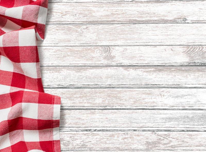 De achtergrond van de keukenlijst met rode picknickdoek stock fotografie