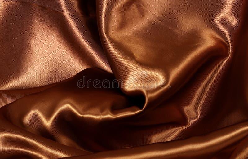 De achtergrond van het de kleurensatijn van de chocolade royalty-vrije stock afbeeldingen