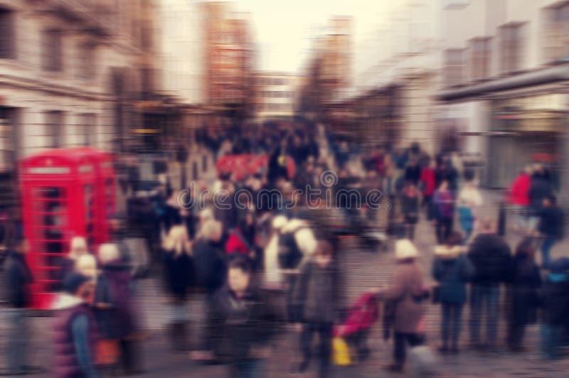 De achtergrond van het Defocusedonduidelijke beeld van mensen die in een straat in Londo lopen royalty-vrije stock afbeelding