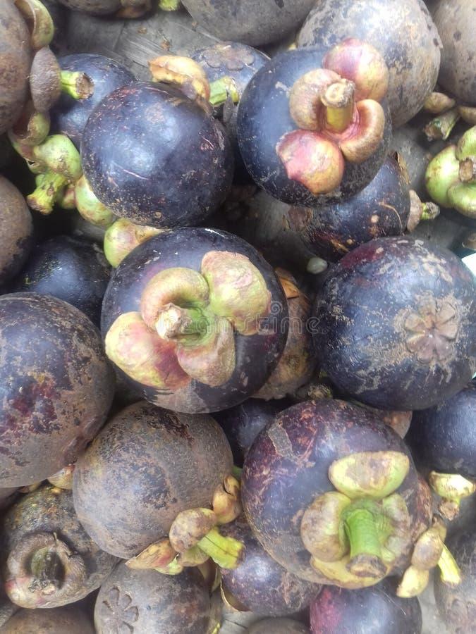 de achtergrond van het mangostanfruit royalty-vrije stock afbeeldingen
