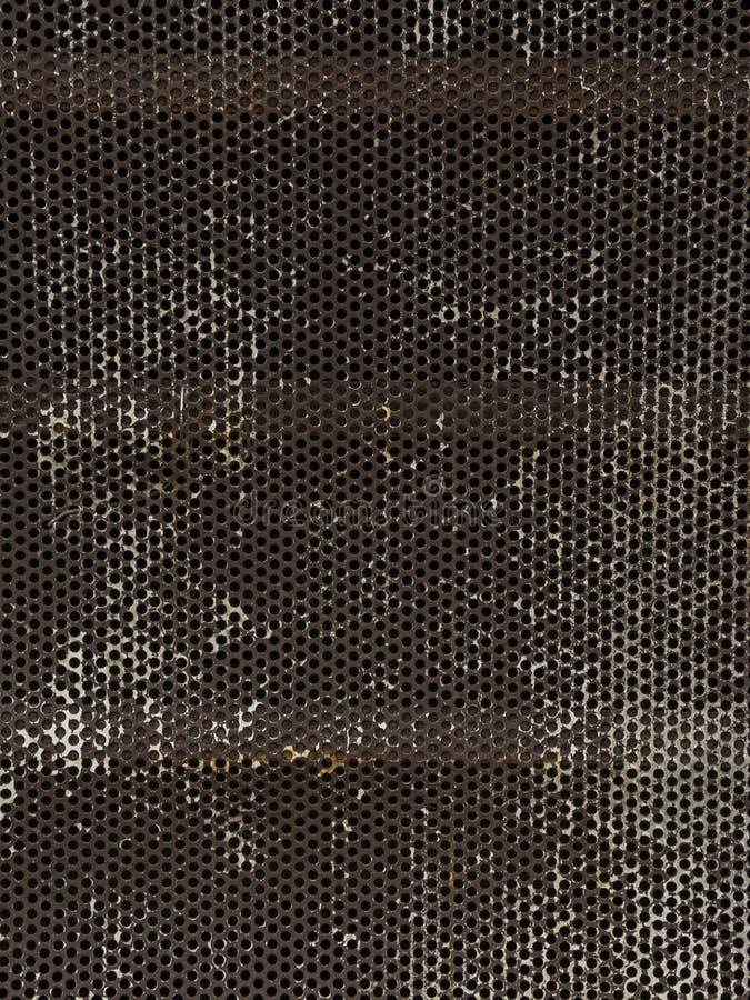 De achtergrond van het metaal met gaten stock afbeelding