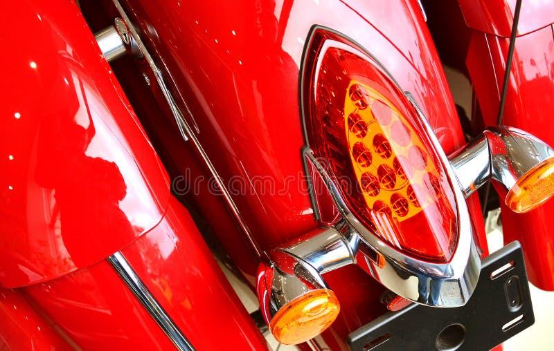 De achtergrond van het motorfietsdetail met koplamp stock foto