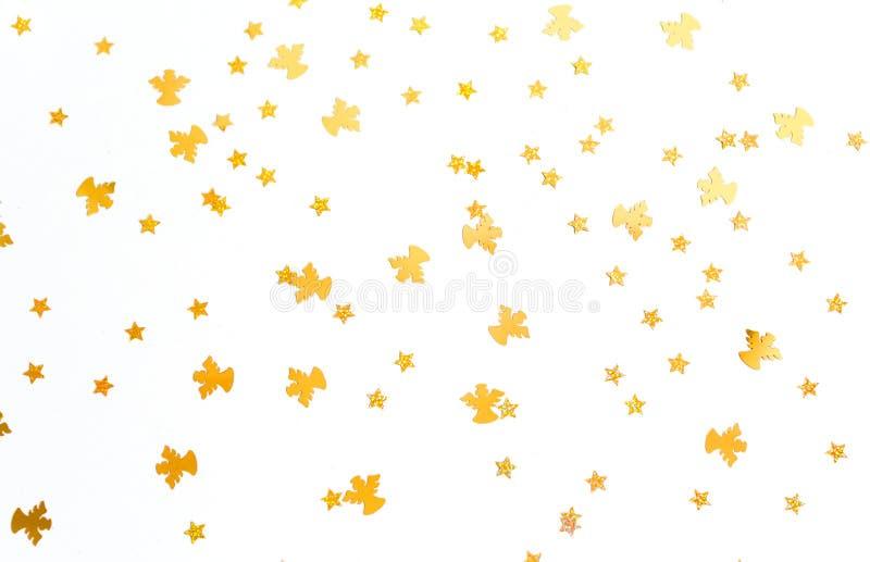 De achtergrond van Kerstmis Gouden engelen en sterren op witte achtergrond stock afbeelding